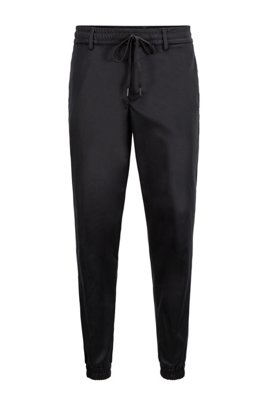 Tapered-fit tracksuit bottoms in water-repellent fabric, Black