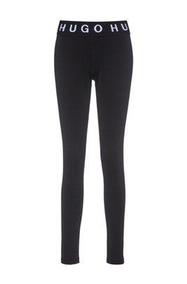 Skinny-Fit Leggings mit kontrastfarbenen Logos, Schwarz