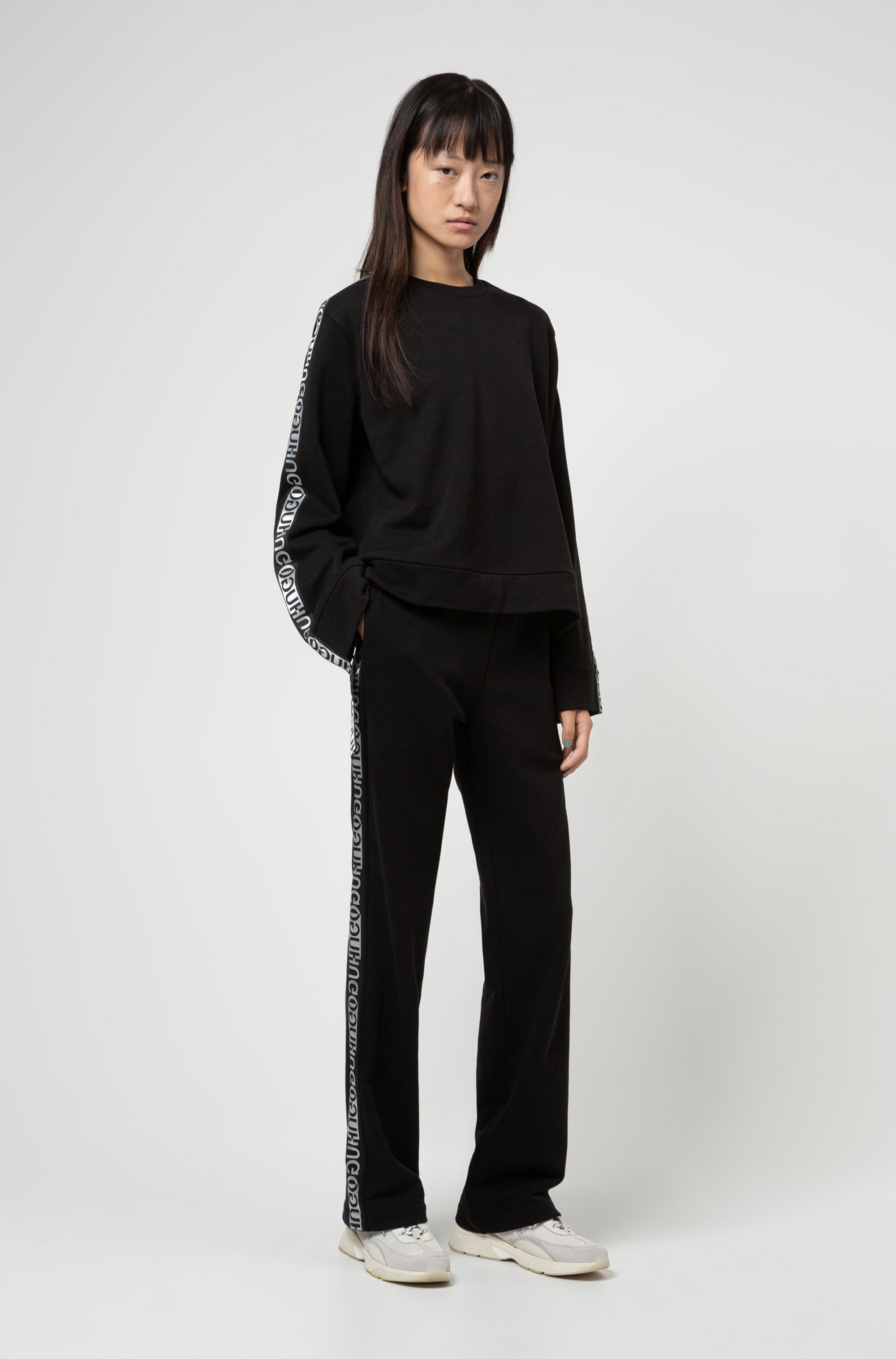 Relaxed-fit jogging trousers with side-seam logo tape