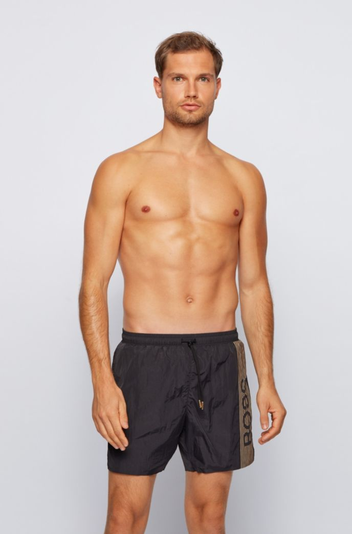 Quick-drying swim shorts with logo and reflective stripes