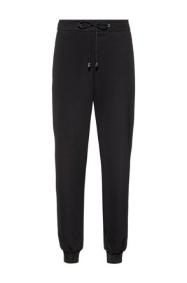 Stretch-fabric tracksuit bottoms with logo cuffs, Black