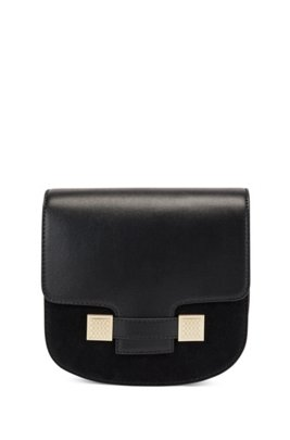 Saddle bag in leather and suede with monogram hardware, Black