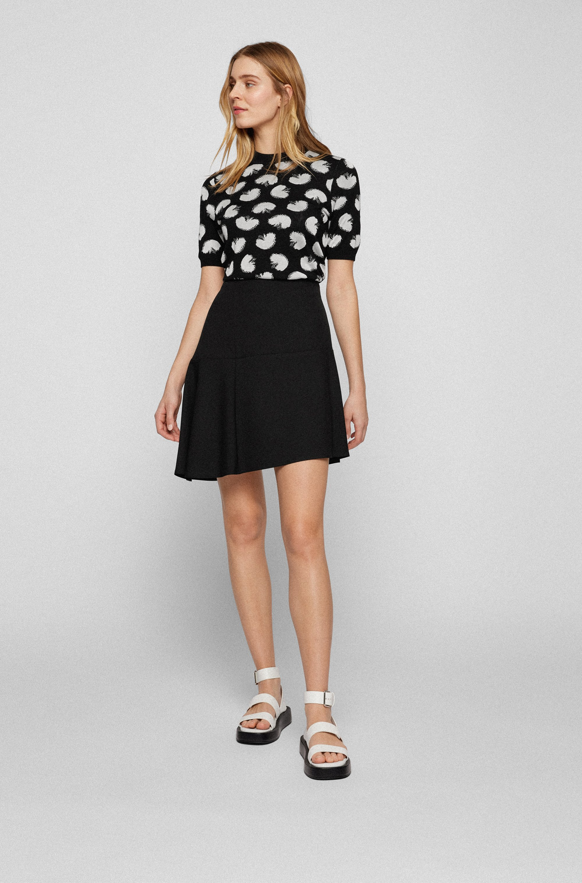 A-line skirt in stretch fabric with asymmetric hem