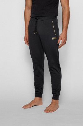 Piqué tracksuit bottoms with metallic accents, Black