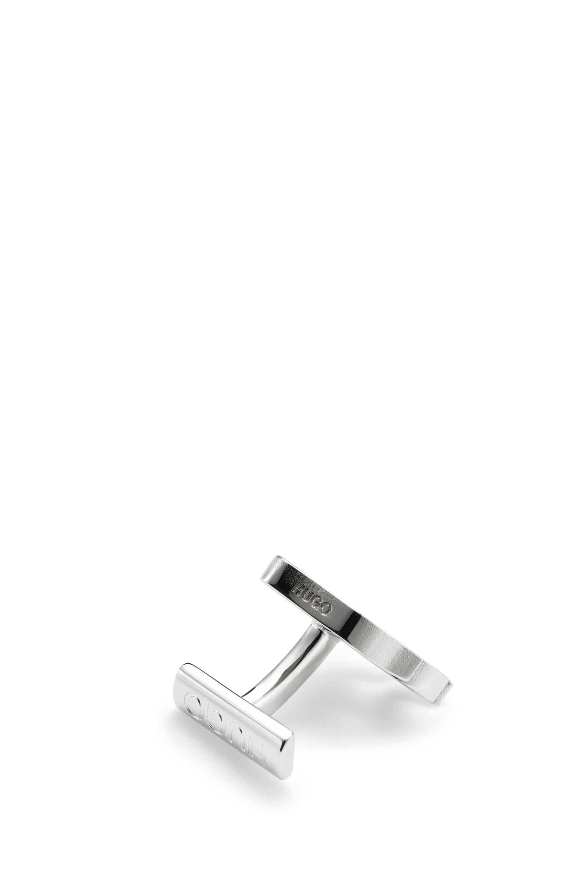 Flame-motif cufflinks in polished brass