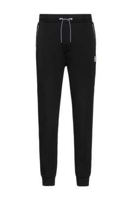 Jogging trousers in stretch fabric with reflective trims, Black