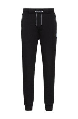 Jogginghose aus Stretch-Gewebe mit reflektierenden Besätzen, Schwarz