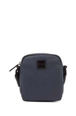 Reporter bag in rubberised faux leather with logo badge, Dark Blue
