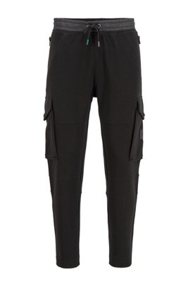 Pantaloni da jogging in french terry con rifiniture iridescenti, Nero