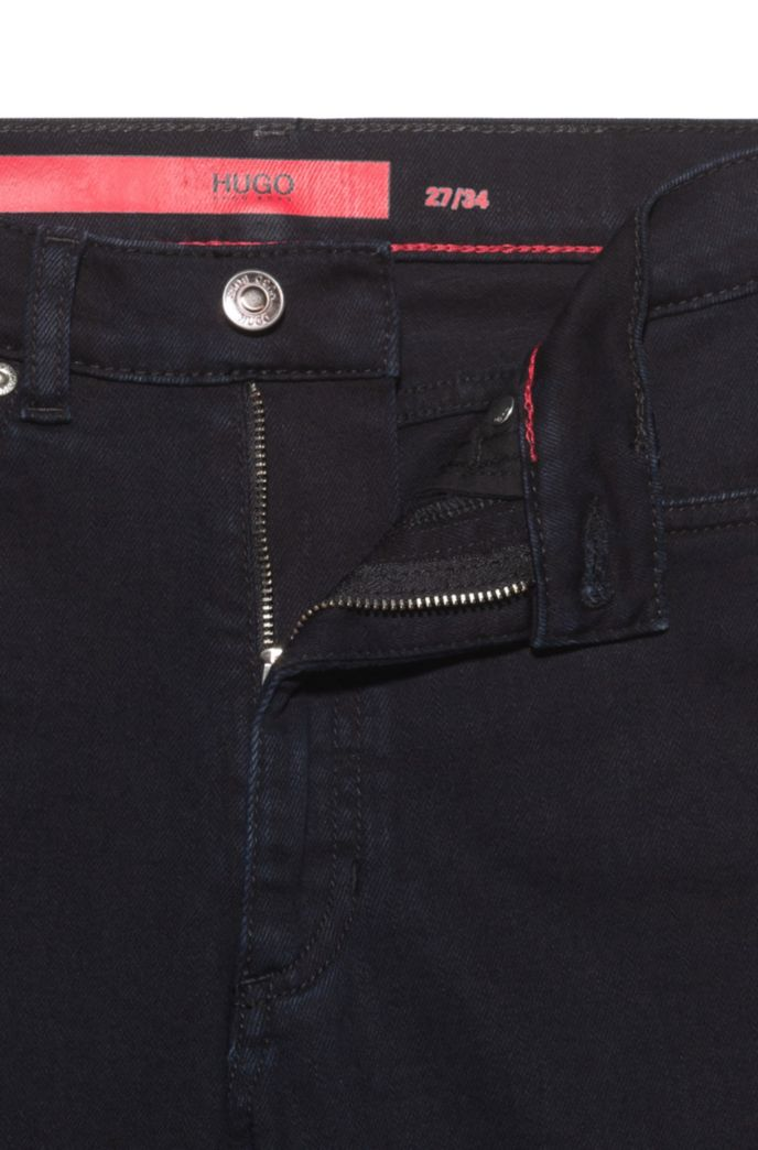 LOU skinny-fit jeans in stretch denim with buttoned hems