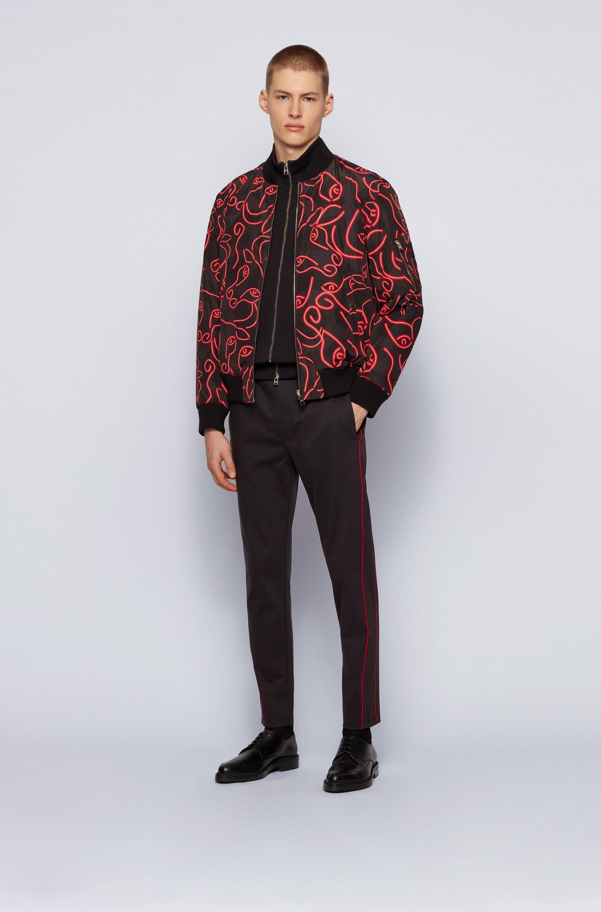 Pantalon de survêtement en coton mélangé à passepoils rouges