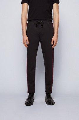 Pantalon de survêtement en coton mélangé à passepoils rouges, Noir