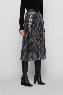 Sequinned midi-length skirt in zebra-print plissé fabric, Patterned