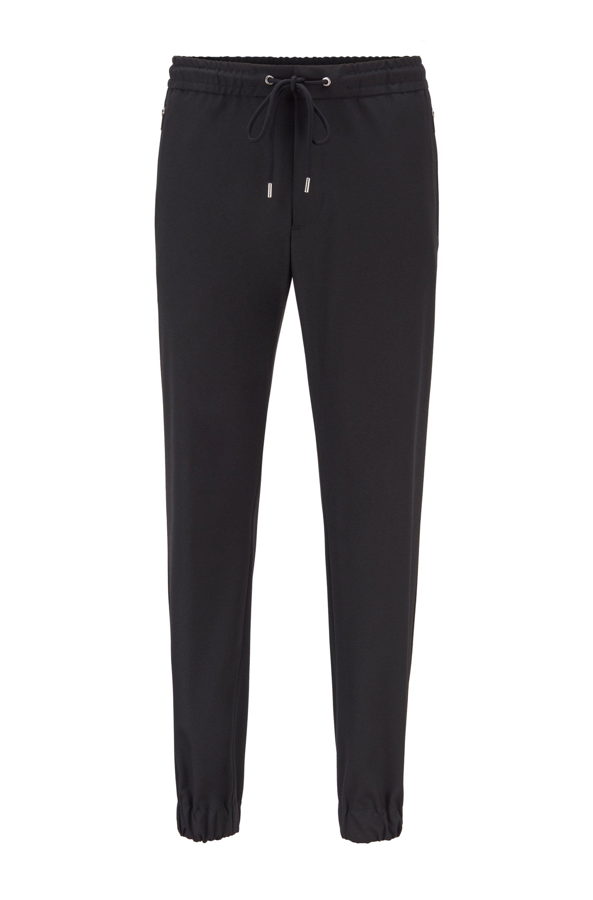 Slim-fit broek met tailleband met trekkoord en zakken met rits, Zwart