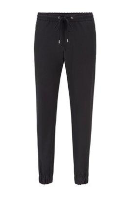 Slim-Fit Hose mit Tunnelzugbund und Reißverschlusstaschen, Schwarz