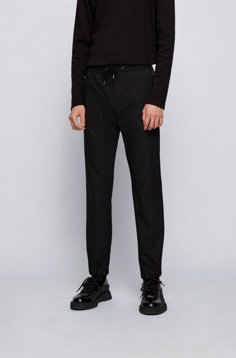 Pantaloni slim fit con vita con coulisse e tasche con zip, Nero