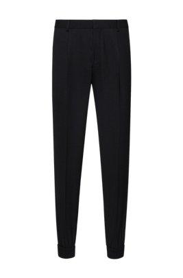 Pantalon Extra Slim Fit resserré au bas des jambes, en tissu très souple, Noir