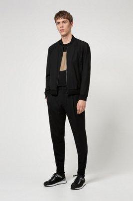 Cuffed extra-slim-fit trousers in super-flex fabric, Black