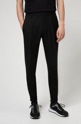 Extra Slim-Fit Hose aus Super-Flex-Gewebe mit Bündchen, Schwarz