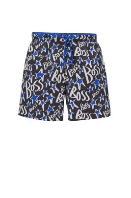 Quick-drying swim shorts with stylised stars and logos, Black