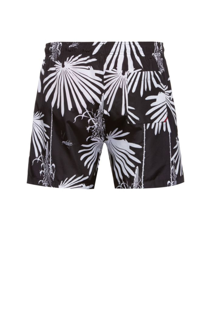 Quick-drying swim shorts with new-season motif