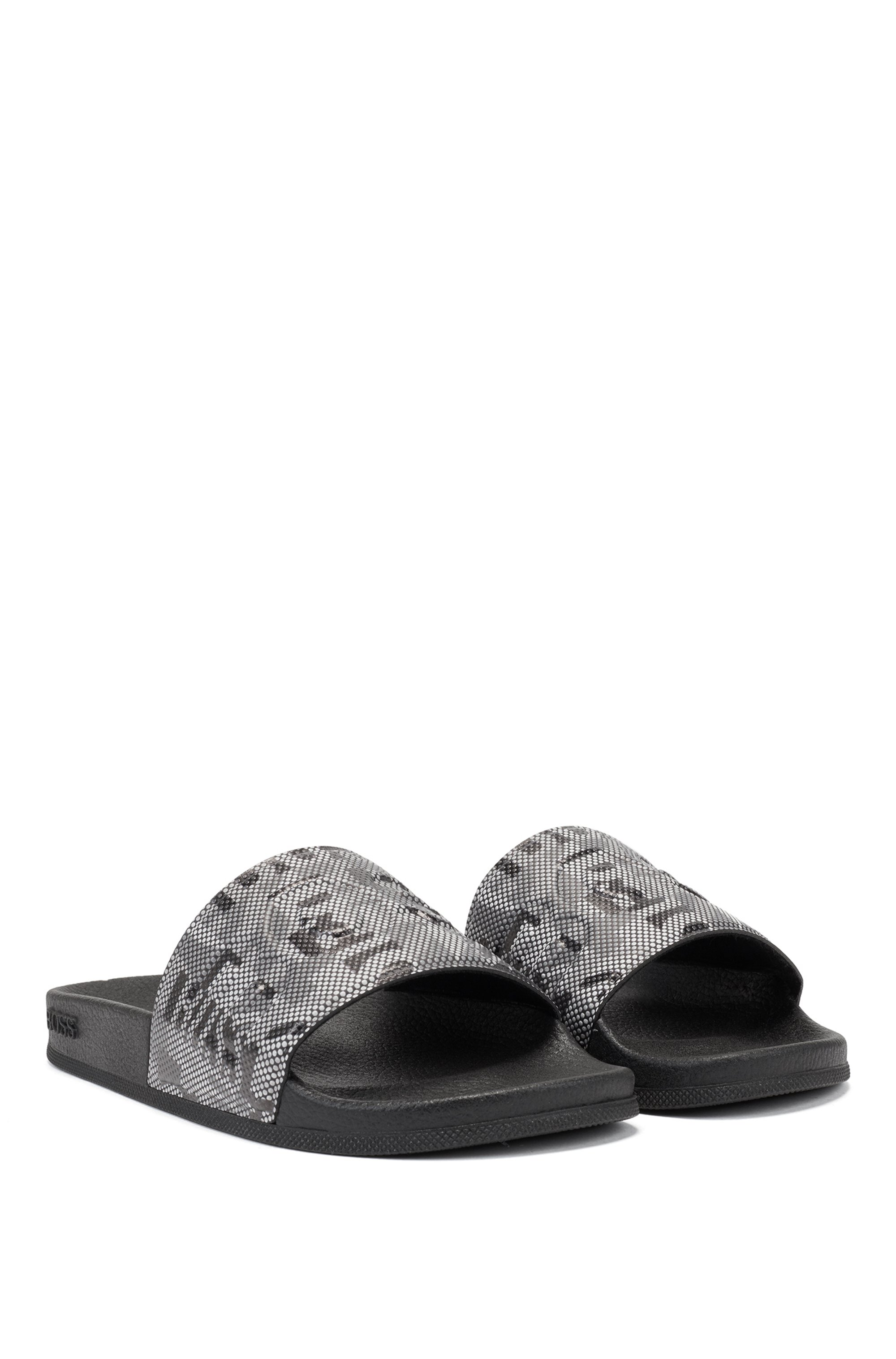 Italian-made slides with branded camouflage strap
