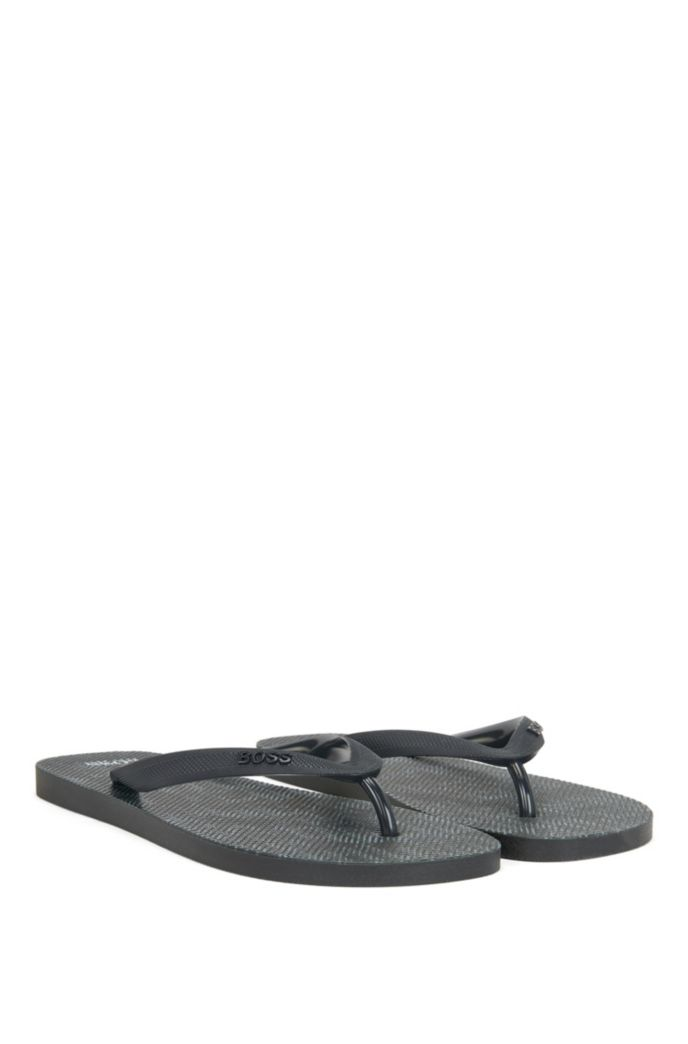 Camouflage-print flip-flops with branded straps