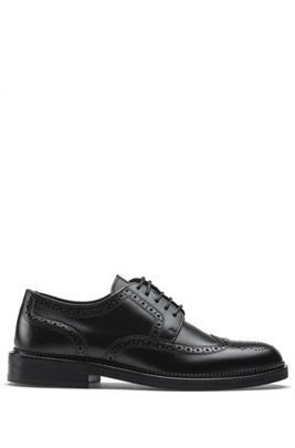 Derby shoes in brush-off leather with brogue details, Black