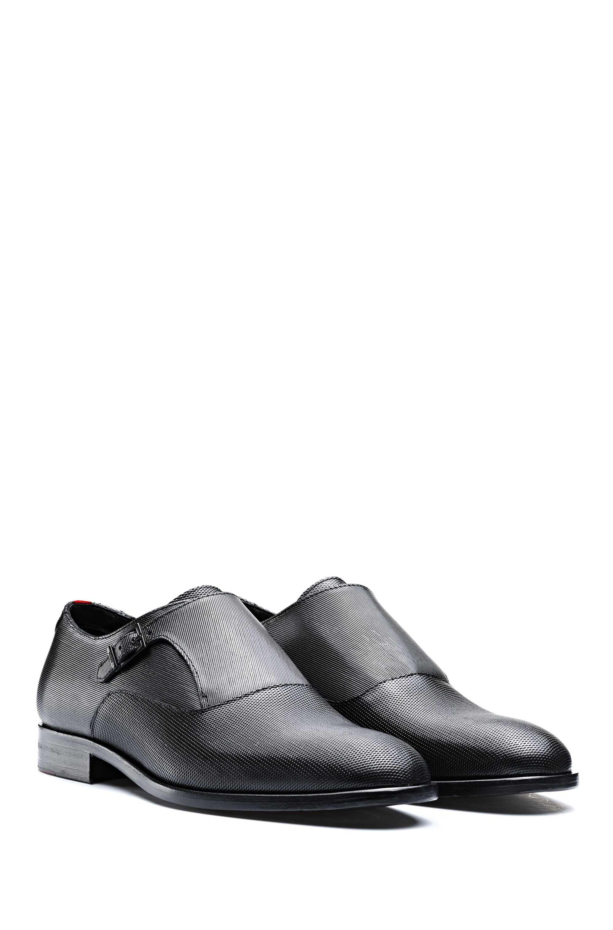 Monk shoes in printed leather with stitched details