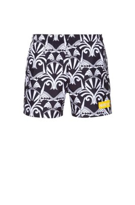 Quick-dry short-length swim shorts with collection artwork, White