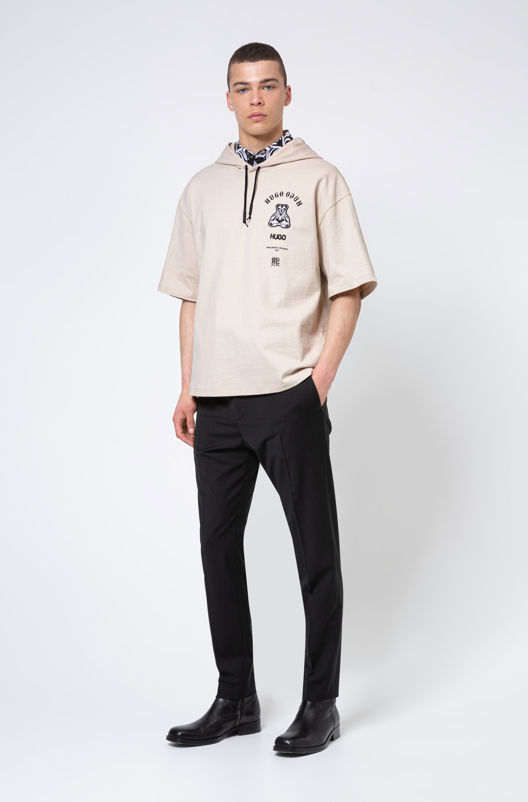 Short-sleeved hooded sweatshirt with collection-themed artwork