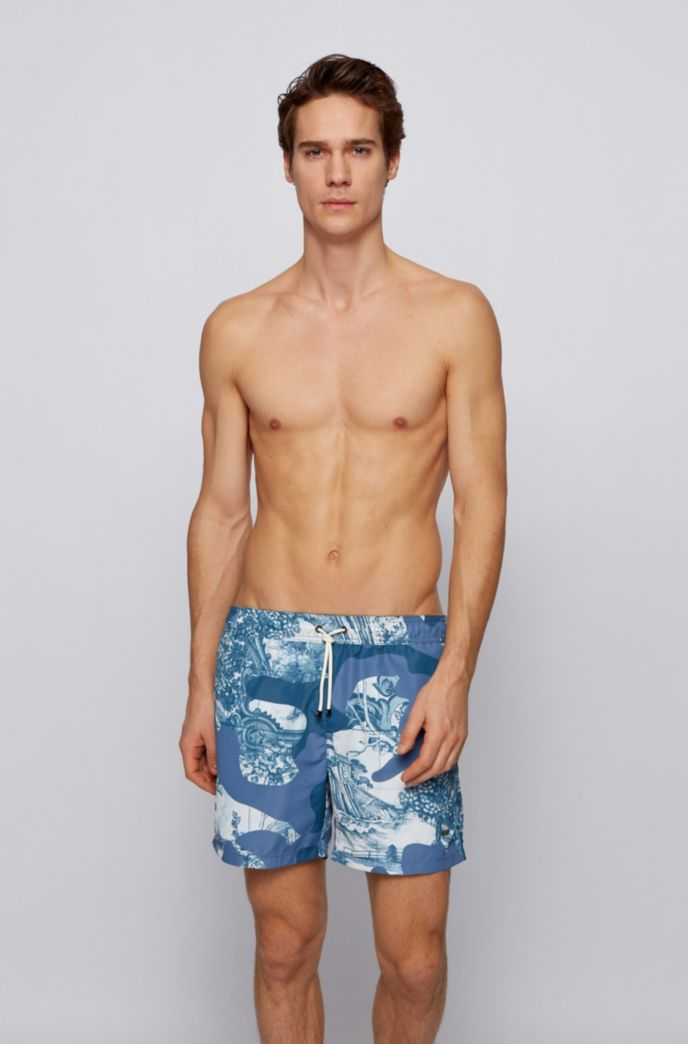 Quick-dry swim shorts in camouflage-print recycled fabric