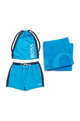 Beach towel and swim shorts in branded drawstring bag, Blue