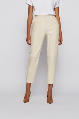 High-waisted slim-fit leather trousers with button detailing, White