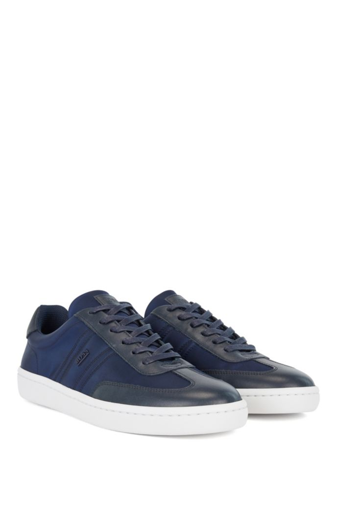 Leather-faced trainers with metallic logo trim