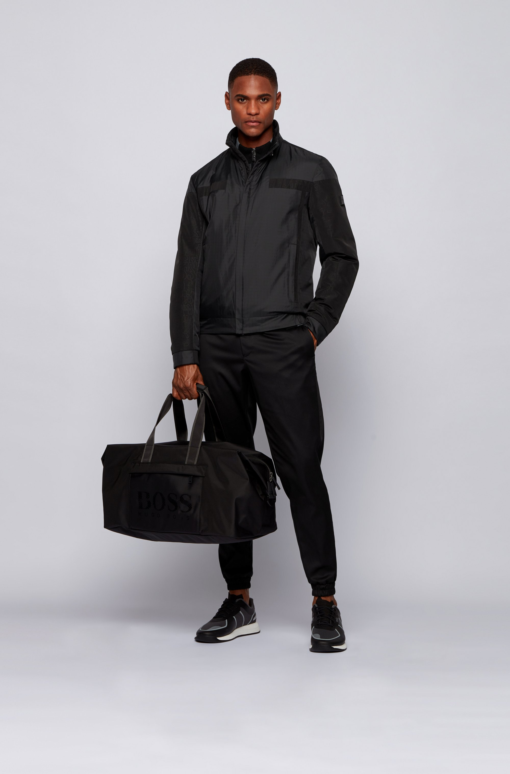 Zip-through holdall in structured nylon with logo print