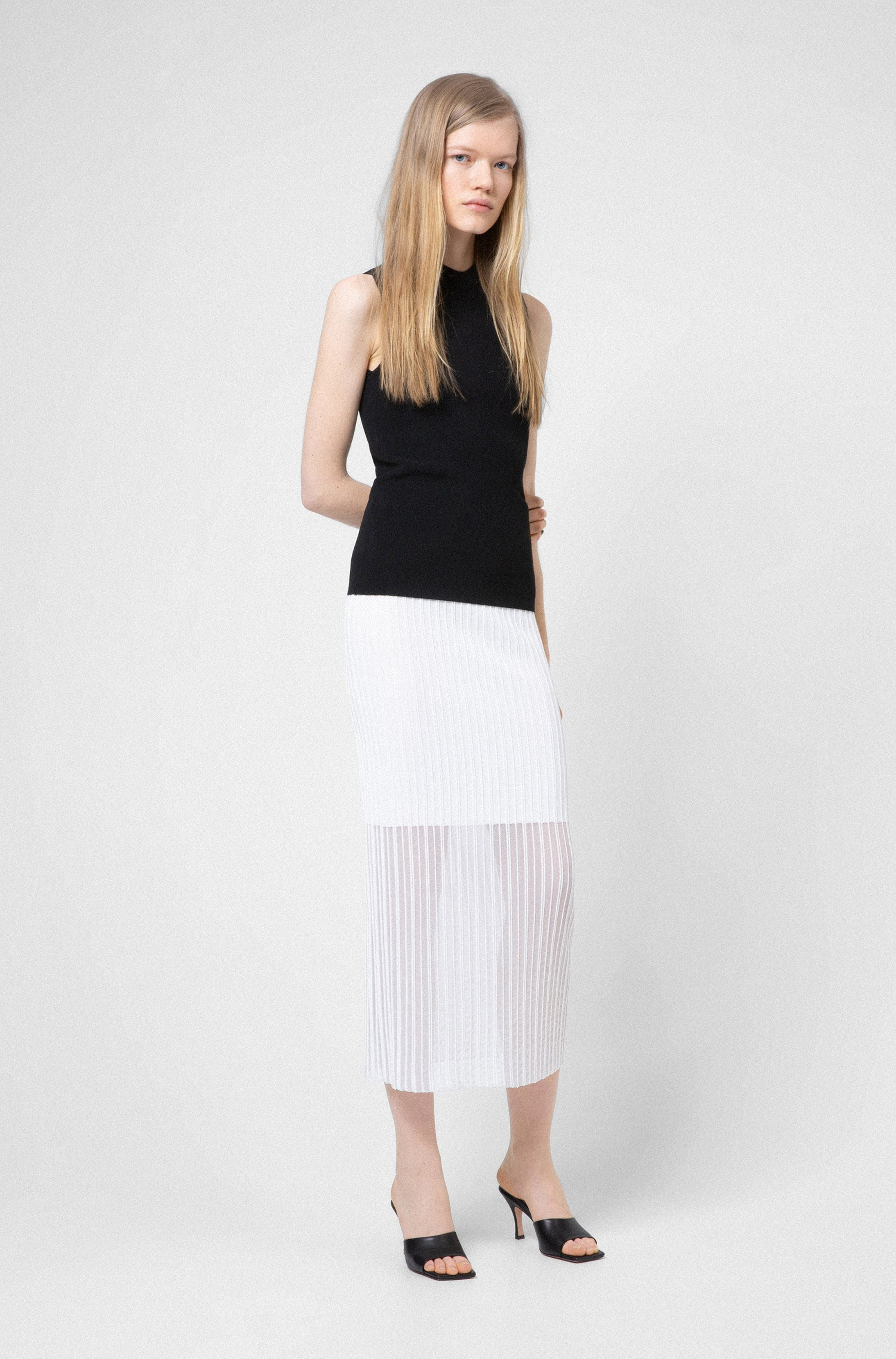 Slim-fit sleeveless top in knitted stretch fabric