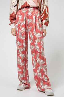 Relaxed-fit flared trousers in crane-print fabric , Patterned