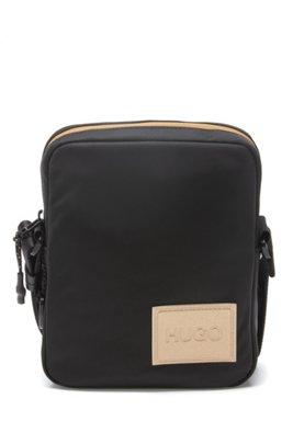 Reporter bag in tessuto tecnico con finiture effetto dorato, Nero