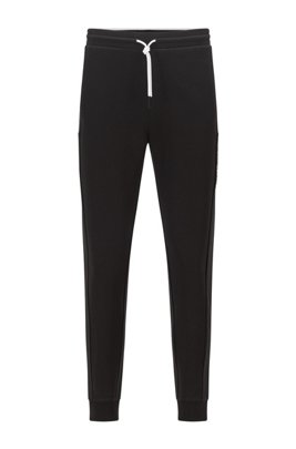Cuffed-hem tracksuit bottoms with colour-block logo, Black