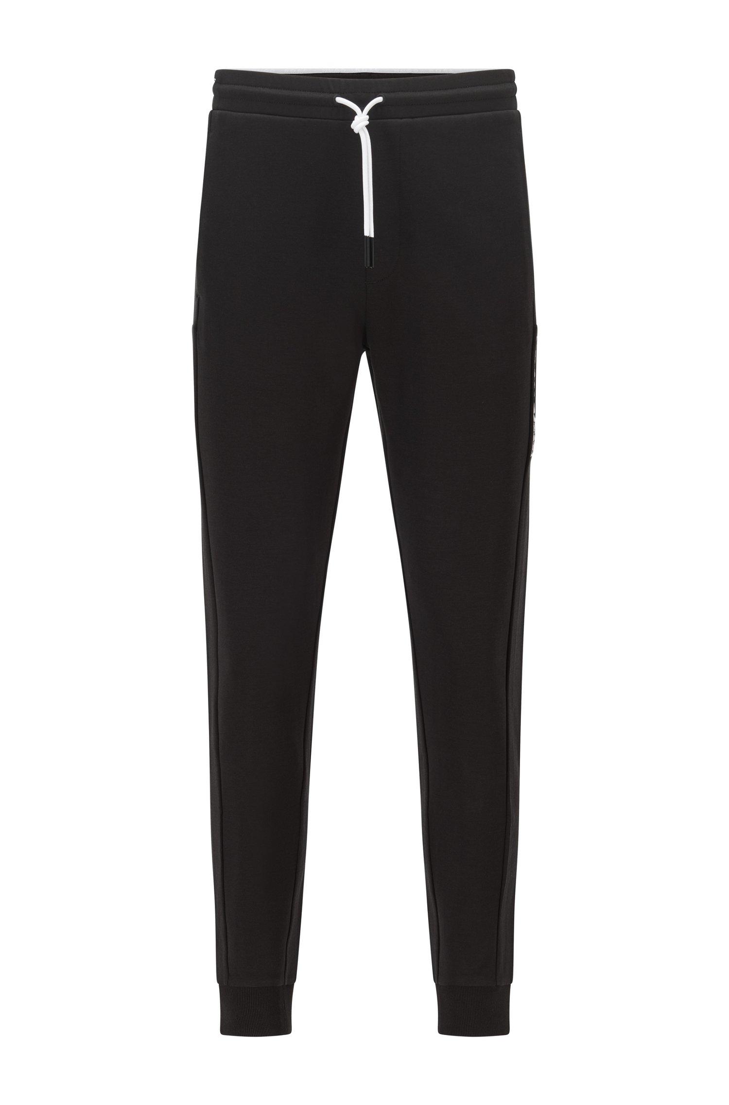 Cuffed-hem tracksuit bottoms with colour-block logo, Black