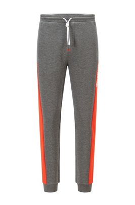 Cuffed-hem tracksuit bottoms with colour-block logo, Grey