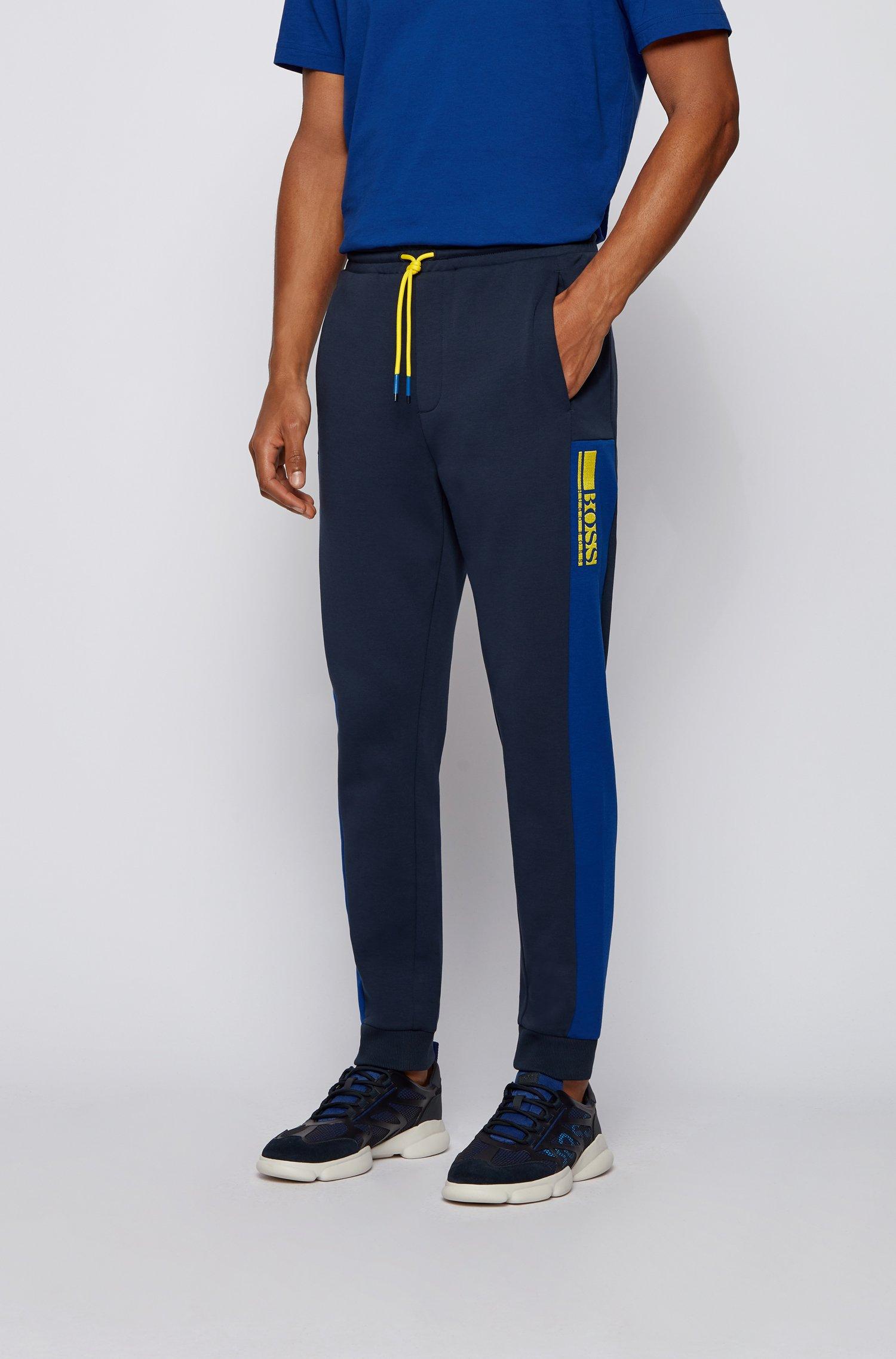 Cuffed-hem tracksuit bottoms with colour-block logo, Dark Blue