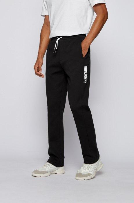 Interlock-jersey tracksuit bottoms with colour-block logo, Black
