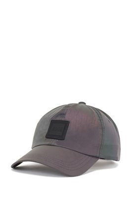 Reflective iridescent cap with rubberised logo badge, Patterned