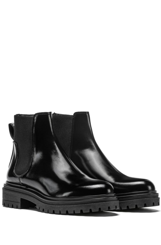 Lug-sole Chelsea booties in brush-off leather