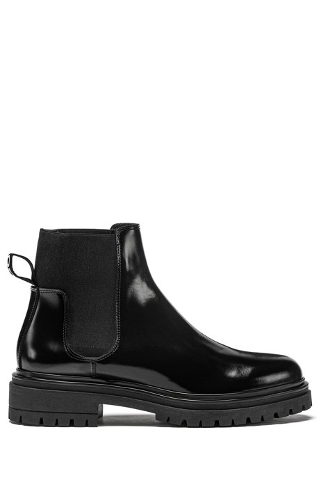Lug-sole Chelsea booties in brush-off leather, Black