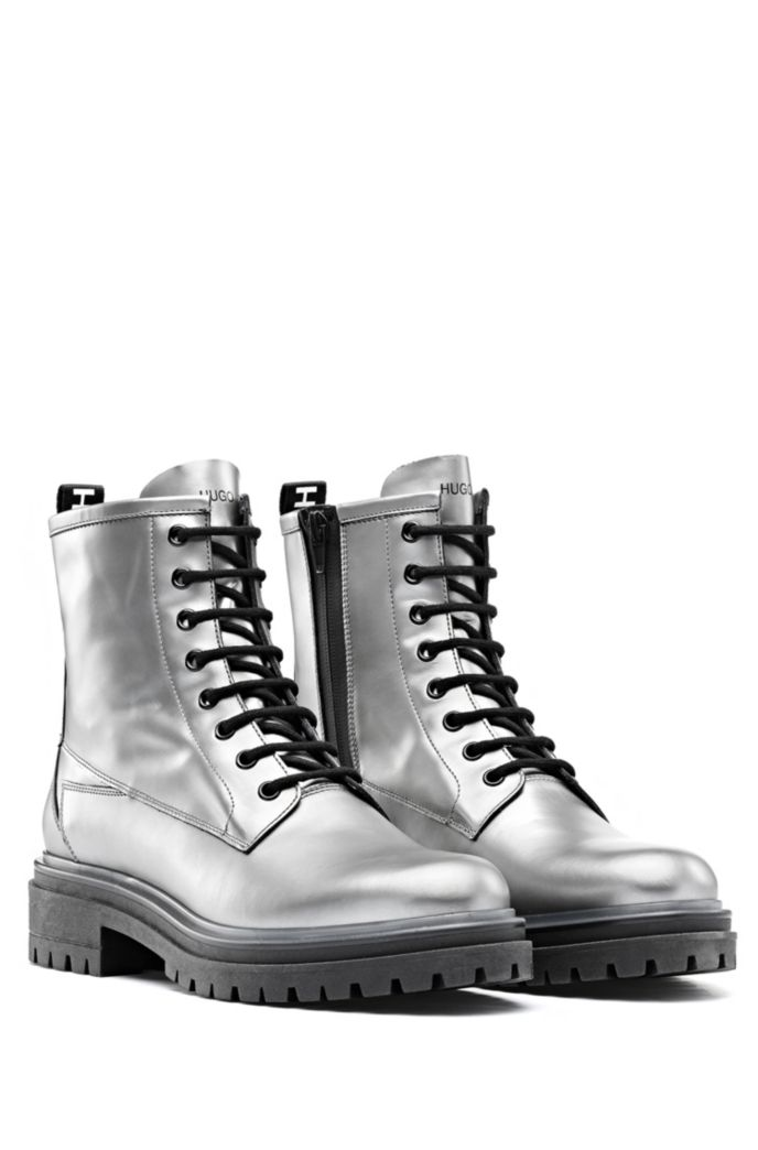 Lug-sole lace-up boots in laminated Italian leather