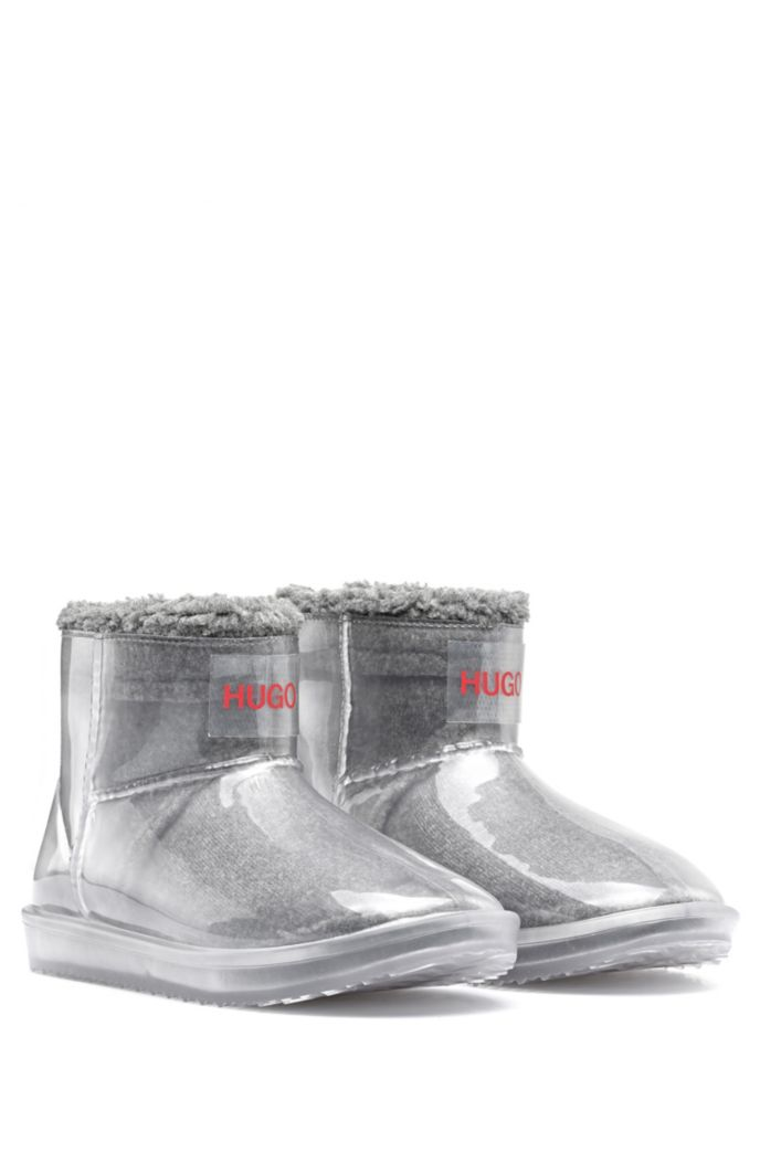Transparent booties with faux-shearling lining