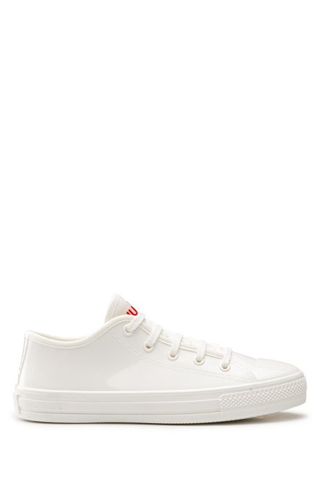Low-profile lace-up trainers in glossy rubber, White